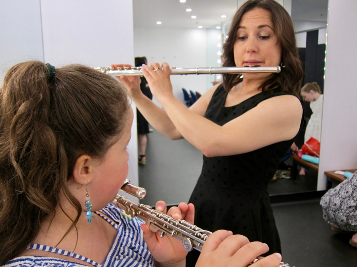 Flutes tuning up in the green room before a concert.