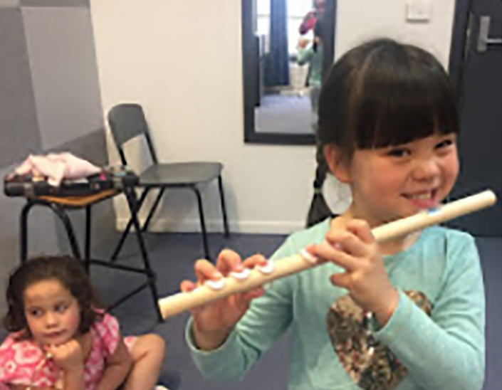 Grasshopper Grace with her new baby flute.